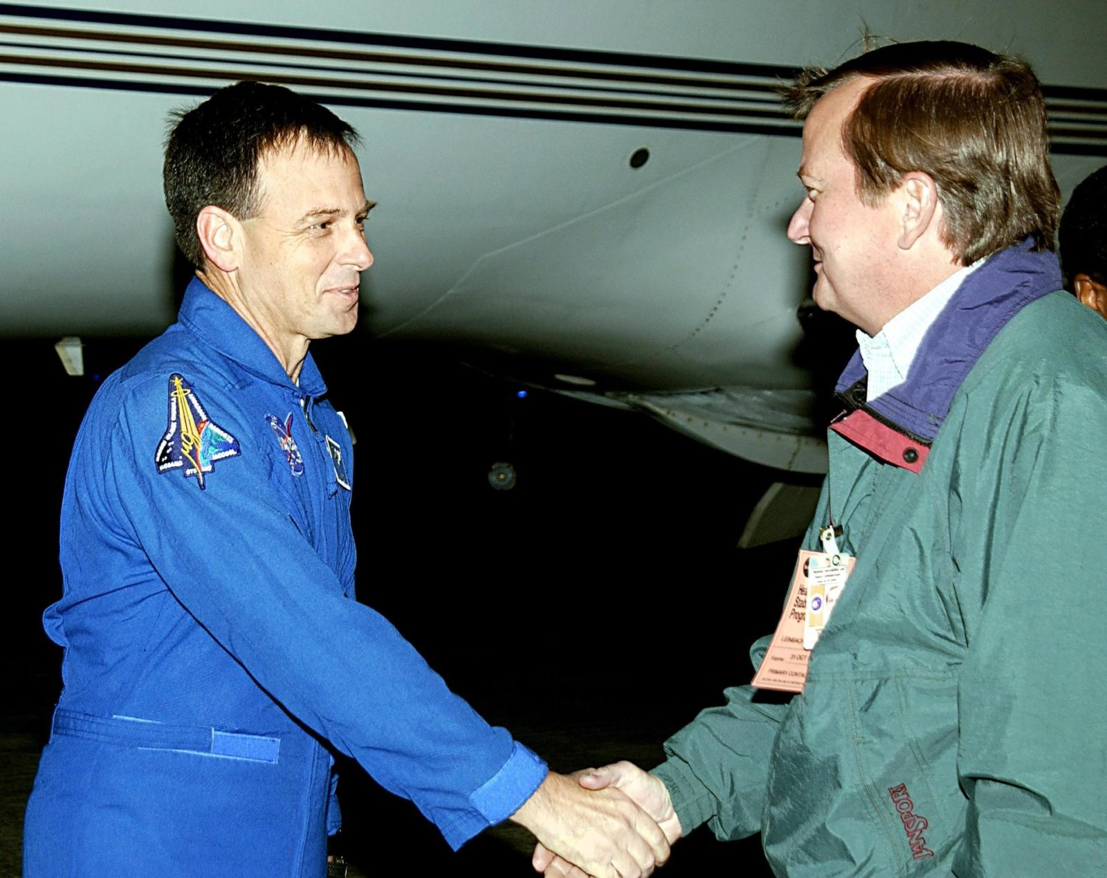 "KENNEDY SPACE CENTER, FLA. --  STS-107 Payload Specialist Ilan Ramon (left) is greeted on his arrival by Launch Director Mike Linebach.  Ramon is the first Israeli astronaut to fly on a Shuttle mission. STS-107 is a mission devoted to research and will include more than 80 experiments that will study Earth and space science, advanced technology development, and astronaut health and safety. The payload on Space Shuttle Columbia includes FREESTAR (Fast Reaction Experiments Enabling Science, Technology, Applications and Research) and the SHI Research Double Module (SHI/RDM), known as SPACEHAB.  Experiments on the module range from material sciences to life sciences.  Other crew members are Commander Rick Husband, Pilot William ""Willie"" McCool, Payload Commander Michael Anderson and Mission Specialists Kalpana Chawla, David Brown and Laurel Clark.  Launch of Columbia is targeted for Jan. 16 between 10 a.m. and 2 p.m. KSC-03pd0050"