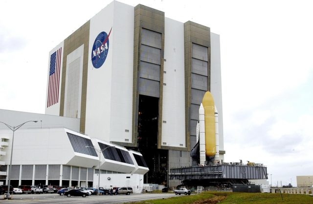 KENNEDY SPACE CENTER, FLA. -- Space Shuttle Atlantis rolls toward Bay 1 in the Vehicle Assembly Building.  There Atlantis will be demated with the external tank and solid rocket boosters in anticipation of its transfer to the Orbiter Processing Facility. KSC-03pd0573