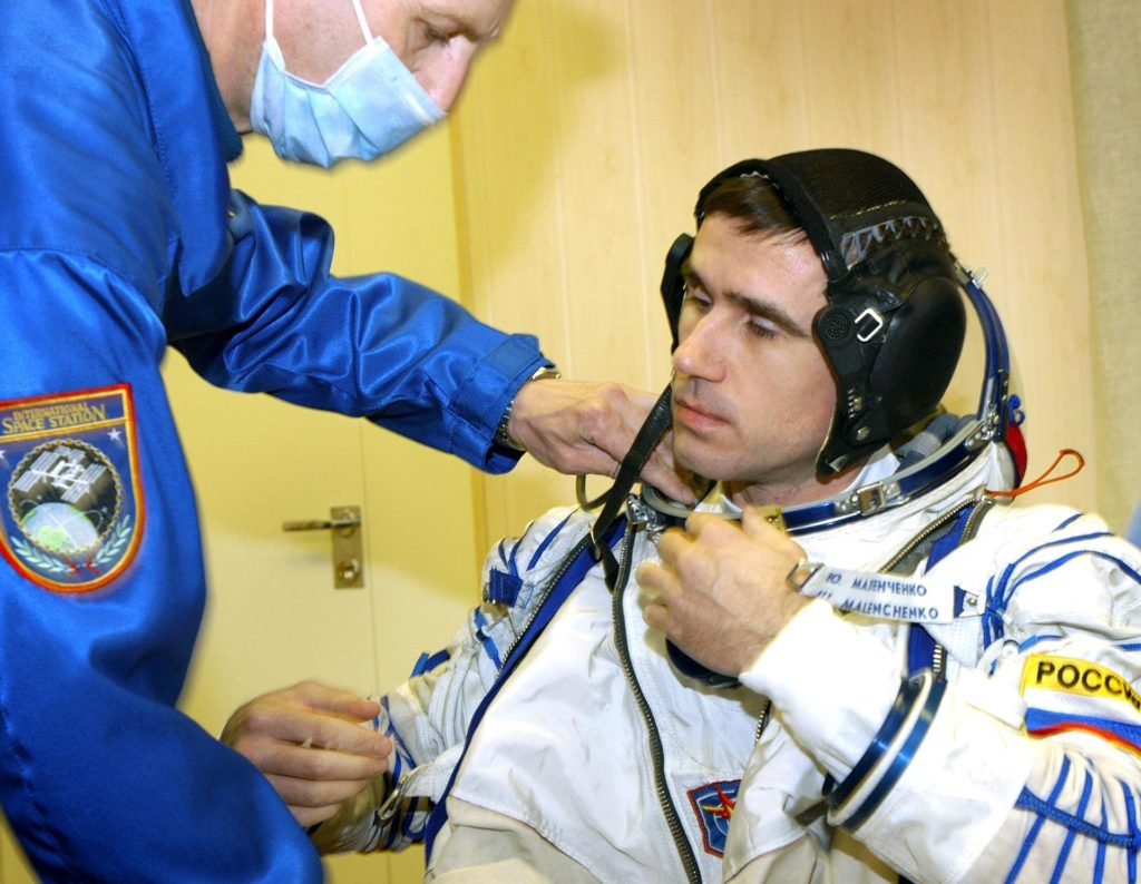 Baikonur Cosmodrome, Kazakhstan -- Cosmonaut Yuri I. Malenchenko, Expedition Seven commander dons his Russian Sokol suit for the leak check and Soyuz inspection, seat liner check. Veteran Russian cosmonaut Yuri Malenchenko and veteran NASA astronaut Ed Lu have been named as the primary crew for the planned April 26, 2003, launch of a Russian Soyuz TMA-2 spacecraft to the International Space Station. Malenchenko and Lu will be called the Expedition 7 crew. Russian cosmonaut Alexander Kaleri and NASA astronaut Michael Foale are the backup crewmembers to Malenchenko and Lu.  Expedition 6 Commander Ken Bowersox, Flight Engineer Nikolai Budarin and NASA Space Station Science Officer Don Pettit will return to Earth aboard the Soyuz TMA-1 craft in May 2003. The three Expedition 6 crewmembers were launched on Nov. 23, 2002. They have been aboard the Station since November 25. They were originally scheduled to return in March aboard the Space Shuttle Atlantis during the STS-114 mission.  Malenchenko and Lu will continue to operate the science payloads already on board, as well as maintaining the Station.  Photo Credit: NASA/Bill Ingalls KSC-03pd1256