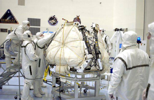 KENNEDY SPACE CENTER, FLA. - Kevin Burke, with the Jet Propulsion Laboratory in Pasadena, Calif., checks the closure of the lander petals and rover egress hardware around the Mars Exploration Rover 2 (MER-A).  Visible now are the airbags that will inflate to cushion the landing on Mars.  The lander and rover will subsequently be enclosed within an aeroshell for launch.  The MER Mission consists of two identical rovers designed to cover roughly 110 yards each Martian day over various terrain. Each rover will carry five scientific instruments that will allow it to search for evidence of liquid water that may have been present in the planet's past.  Identical to each other, the rovers will land at different regions of Mars.  Launch date for this first of NASA's two Mars Exploration Rover missions is scheduled no earlier than June 6. KSC-03pd1227