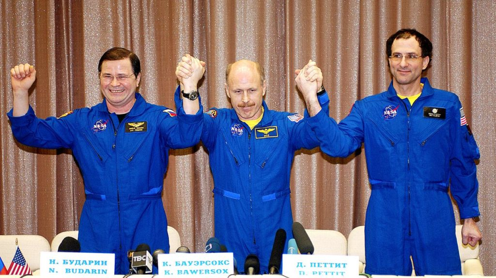 "May 6, 2003.  Star City, Russia. Expedition Six Flight Engineer Nikolai Budarin (L), Commander Ken Bowersox (C),  and NASA ISS Science Officer Don Pettit (R) pose for photos at a Press Conference at the Gagarin Cosmonaut Training Center in Star City, Russia.  Photo Credit: ""NASA/Bill Ingalls"" 03pd1537"