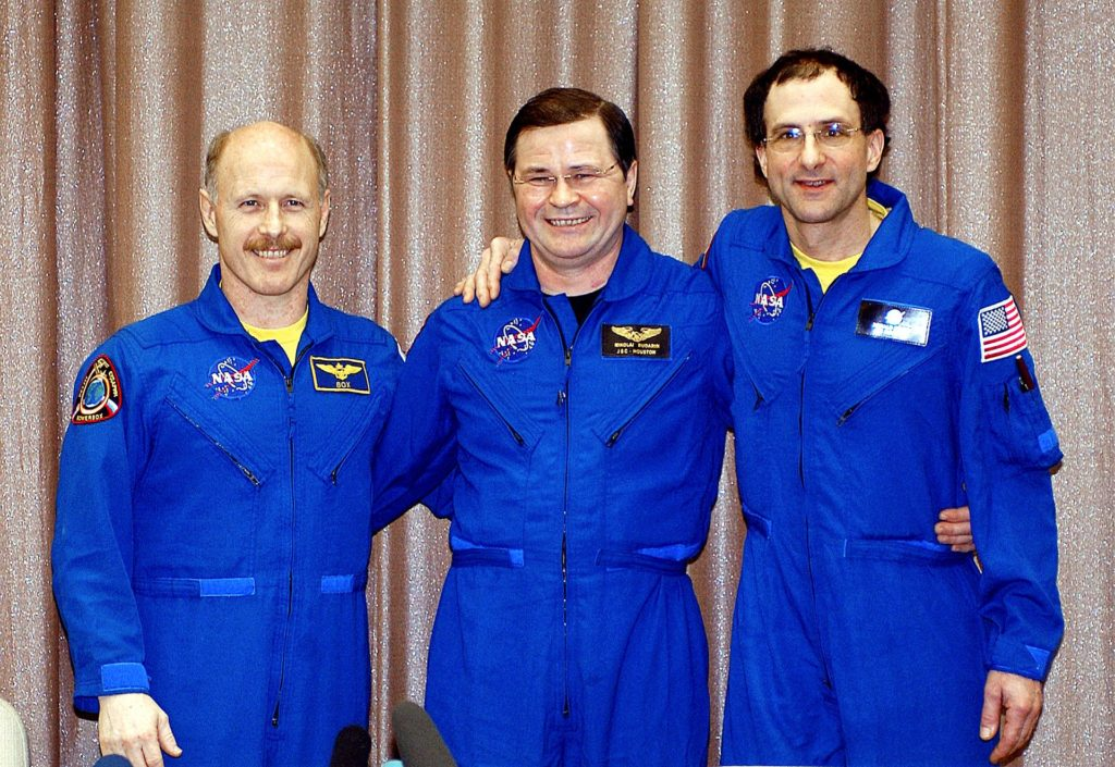 """May 6, 2003.  Star City, Russia. Expedition Six Flight Engineer Nikolai Budarin (L), Commander Ken Bowersox (C),  and NASA ISS Science Officer Don Pettit (R) pose for photos at a Press Conference at the Gagarin Cosmonaut Training Center in Star City, Russia.  Photo Credit: """"NASA/Bill Ingalls"""" 03pd1538"""