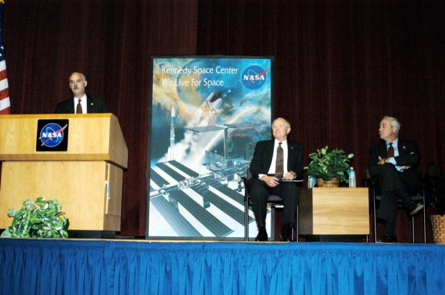 KENNEDY SPACE CENTER, FLA. -  NASA Associate Administrator for Space Flight William F. Readdy addresses a group of KSC employees assembled in the KSC Training Auditorium. From left are Readdy, KSC Center Director Roy D. Bridges, and NASA Administrator Sean O'Keefe. The occasion is the announcement of James W. Kennedy as the next director of the NASA Kennedy Space Center (KSC) in Florida. Kennedy has served as KSC's deputy director since November 2002. He will succeed Bridges, who was appointed on June 13 to lead NASA's Langley Research Center, Hampton, Va.