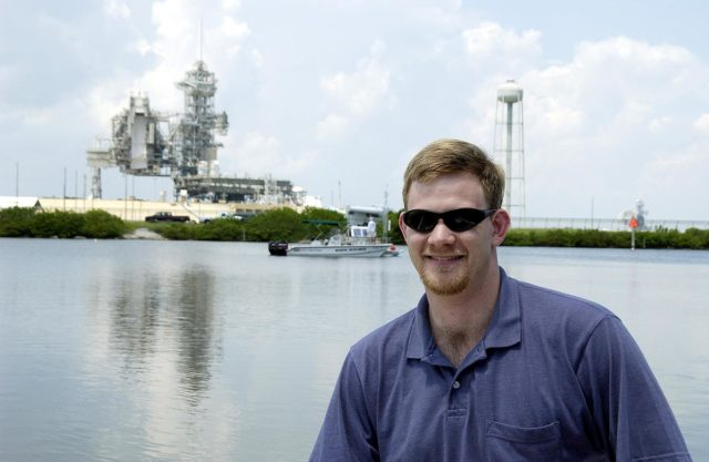 KENNEDY SPACE CENTER, FLA.  -  Justin Manley, of the National Oceanic and Atmospheric Administration, is a member of the research team conducting underwater acoustic research in the Launch Complex 39 turn basin near Launch Pad 39A.  Several government agencies, including NASA, NOAA, the Navy, the Coast Guard, and the Florida Fish and Wildlife Commission are involved in the testing. The research involves demonstrations of passive and active sensor technologies, with applications in fields ranging from marine biological research to homeland security. The work is also serving as a pilot project to assess the cooperation between the agencies involved. Equipment under development includes a passive acoustic monitor developed by NASA's Jet Propulsion Laboratory, and mobile robotic sensors from the Navy's Mobile Diving and Salvage Unit.