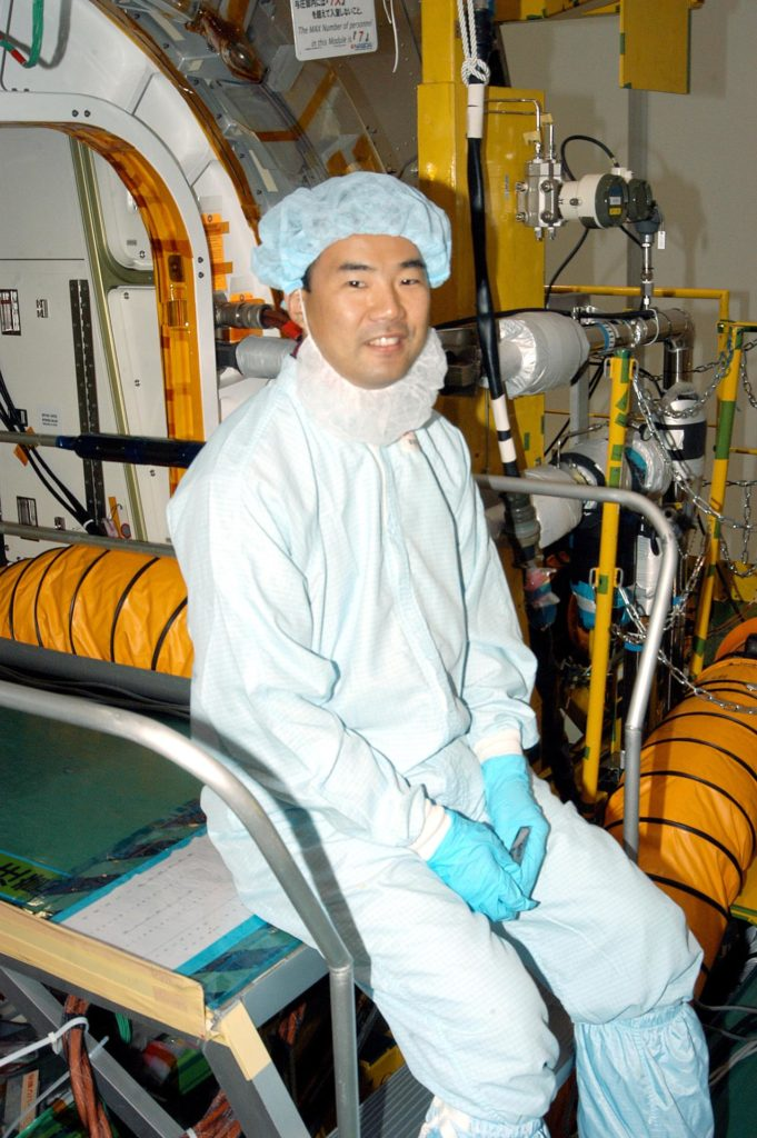 KENNEDY SPACE CENTER, FLA. -  Astronaut Soichi Noguchi, with the National Space Development Agency of Japan (NASDA), rests inside the Japanese Experiment Module (JEM), undergoing a Multi-Element Integrated Test (MEIT)  in the Space Station Processing Facility.  Noguchi is assigned to mission STS-114 as a mission specialist.   Node 2 attaches to the end of the U.S. Lab on the ISS and provides attach locations for the Japanese laboratory, European laboratory, the Centrifuge Accommodation Module and, eventually, Multipurpose Logistics Modules. It will provide the primary docking location for the Shuttle when a pressurized mating adapter is attached to Node 2.  Installation of the module will complete the U.S. Core of the ISS.   The JEM, developed by NASDA,  is Japan's primary contribution to the Station. It will enhance the unique research capabilities of the orbiting complex by providing an additional environment for astronauts to conduct science experiments.
