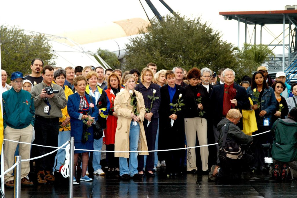 KENNEDY SPACE CENTER, FLA. -  Friends, co-workers and families gather at the Space Memorial Mirror for KSC's special service remembering and honoring the crew of Columbia.  Feb. 1 is the one-year anniversary of the loss of the crew and orbiter Columbia in a tragic accident as the ship returned to Earth following mission STS-107.  The public was invited to the memorial service held at the KSC Visitor Complex.  Participants included Center Director Jim Kennedy, Deputy Director Woodrow Whitlow Jr., Executive Director of Florida Space Authority Winston Scott, Dr. Stephen Feldman, president of the Astronaut Memorial Foundation, and dancers from the Shoshone-Bannock Native American community in Fort Hall, Idaho.