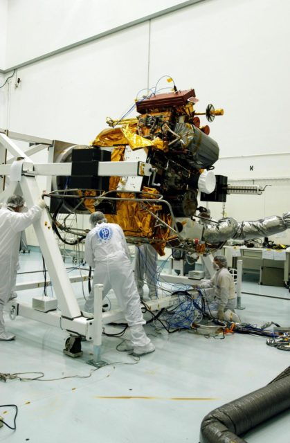 KENNEDY SPACE CENTER, FLA. -- - Astrotech Space Operations facilities near KSC, workers check the Mercury Surface, Space Environment, Geochemistry and Ranging (MESSENGER) spacecraft  as it rotates on the turnover fixture.  Workers will perform the propulsion system phasing test - firing gas through the thrusters in order to verify that the right thrusters fire when expected - as part of prelaunch testing at the site.  Launch is scheduled for May 11 from Pad 17-B, Cape Canaveral Air Force Station. The spacecraft will fly past Venus three times and Mercury twice before starting a year-long orbital study of Mercury in July 2009. KSC-04pd0675