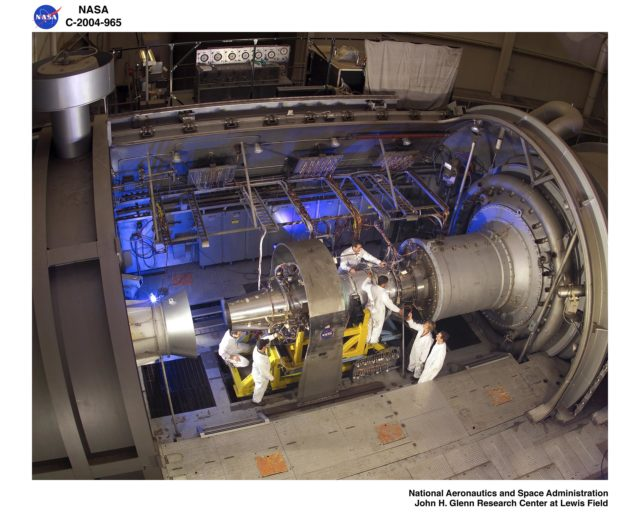 Jet engine being set up for testing with technicians from Propulsion System lab PSL GRC-2004-C-00965