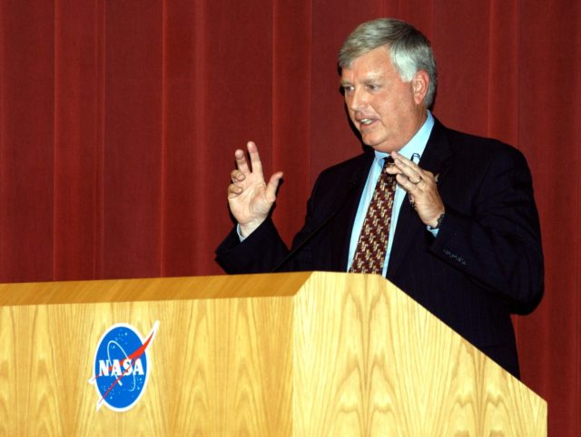 KENNEDY SPACE CENTER, FLA. -- Center Director James W. Kennedy addresses KSC employees assembled in the Training Auditorium for a Culture Change Process All Hands Meeting.  The purpose of the meeting was for employees to gain further insight into the Agency's Vision for Space Exploration and the direction cultural change will take at KSC in order to assume its role within this vision. Other participants included Jim Jennings, Deputy Associate Administrator for Institutions and Asset Management; Lynn Cline, Deputy Associate Administrator for Space Flight; Bob Sieck, former Director of Space Shuttle Processing at KSC; and Jim Wetherbee, astronaut and Technical Assistant to the Director of Safety and Mission Assurance at Johnson Space Center. Following their remarks, members of the panel entertained questions and comments from the audience. KSC-04pd1110