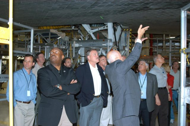 KENNEDY SPACE CENTER, FLA. -- Adm. Craig E. Steidle (center), NASA's associate administrator, Office of Exploration Systems, tours the Orbiter Processing Facility on a visit to KSC.  At right (hands up) is Conrad Nagel, chief of the Shuttle Project Office.  They are standing under the orbiter Discovery.  The Office of Exploration Systems was established to set priorities and direct the identification, development and validation of exploration systems and related technologies to support the future space vision for America.  Steidle's visit included a tour of KSC to review the facilities and capabilities to be used to support the vision. KSC-04pd1139