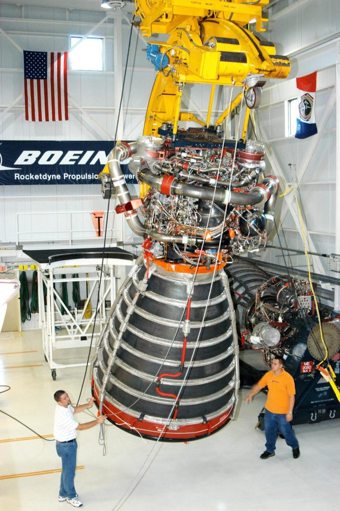 KENNEDY SPACE CENTER, FLA. - In the Space Shuttle Main Engine (SSME) Processing Facility, Boeing-Rocketdyne technicians steady SSME 2058, the first SSME fully assembled at KSC. The engine is being lifted from its vertical work stand into a horizontal position in preparation for shipment to NASA's Stennis Space Center in Mississippi to undergo a hot fire acceptance test. It is the first of five engines to be fully assembled on site to reach the desired number of 15 engines ready for launch at any given time in the Space Shuttle program. A Space Shuttle has three reusable main engines. Each is 14 feet long, weighs about 7,800 pounds, is seven-and-a-half feet in diameter at the end of its nozzle, and generates almost 400,000 pounds of thrust. Historically, SSMEs were assembled in Canoga Park, Calif., with post-flight inspections performed at KSC.  Both functions were consolidated in February 2002. The Rocketdyne Propulsion and Power division of The Boeing Co. manufactures the engines for NASA. KSC-04pd1644