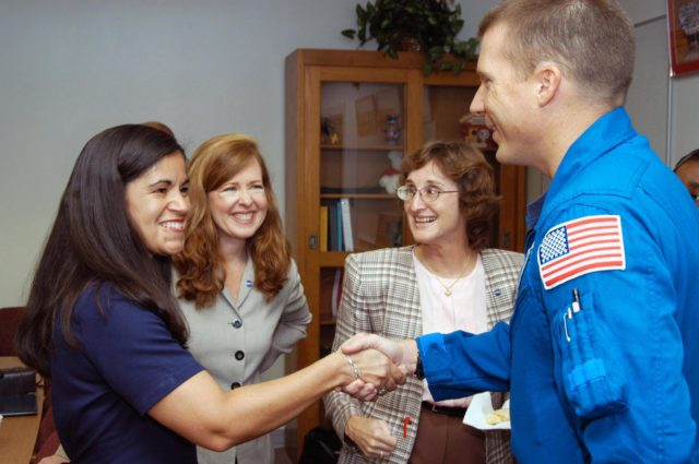 KENNEDY SPACE CENTER, FLA. -  Lisa Scallon (far left), principal of Immokalee Middle School in Naples, Fla., welcomes astronaut Terry Virts to the school, which is part of NASA's Explorer Schools (NES) Program.  Immokalee and Pine Ridge Middle School are an NES team.  Also seen are Lisa Malone (second from left), director, KSC's External Relations and Business Development directorate, and Pam Biegert, chief of Educational Services at KSC, who both accompanied Center Director Jim Kennedy on the trip.  Kennedy is visiting the school to share the  for space exploration with the next generation of explorers.  He is talking with students about our destiny as explorers, NASA's stepping stone approach to exploring Earth, the Moon, Mars and beyond, how space impacts our lives, and how people and machines rely on each other in space.  NES establishes a three-year partnership annually between NASA and 50 NASA Explorer Schools teams, consisting of teachers and education administrators from diverse communities nationwide. KSC-04pd2040