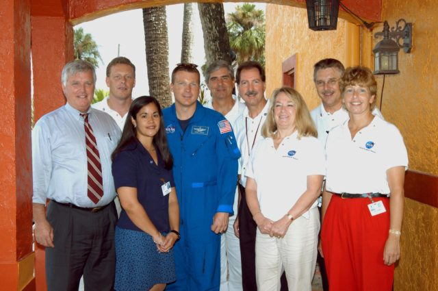 KENNEDY SPACE CENTER, FLA. -  While visiting Immokalee Middle School in Naples, Fla., Center Director Jim Kennedy (far left) and astronaut Terry Virts (fourth from left) pose for a photo with school staff members.  Second from left is the principal, Lisa Scallon.  Immokalee is part of NASA's Explorer School (NES) Program and is teamed with Pine Ridge Middle School. Kennedy visited the school to share the vision for space exploration with the next generation of explorers. He is talking with students about our destiny as explorers, NASA's stepping stone approach to exploring Earth, the Moon, Mars and beyond, how space impacts our lives, and how people and machines rely on each other in space.  NES establishes a three-year partnership annually between NASA and 50 NASA Explorer Schools teams, consisting of teachers and education administrators from diverse communities nationwide. KSC-04pd2055