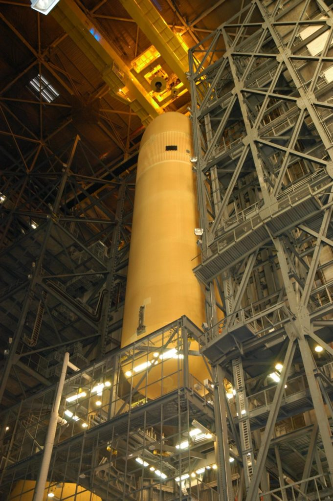 KENNEDY SPACE CENTER, FLA. - External Tank 118 (ET-118) is lifted from its cell in the Vehicle Assembly Building in order to place it on a transporter.  The tank will be transferred to NASA's Michoud Assembly Facility in New Orleans.  The tank is being installed with an improved bipod fitting, which connects the external fuel tank to the Shuttle during launch. The new design, a significant milestone in the effort to return the Shuttle to safe flight, replaces the foam that was used to prevent ice buildup on the tank's bipod fittings with four rod-shaped heaters.  The heaters are being retrofitted on the 11 existing tanks and incorporated into the manufacture of all new tanks. KSC-04pd2128