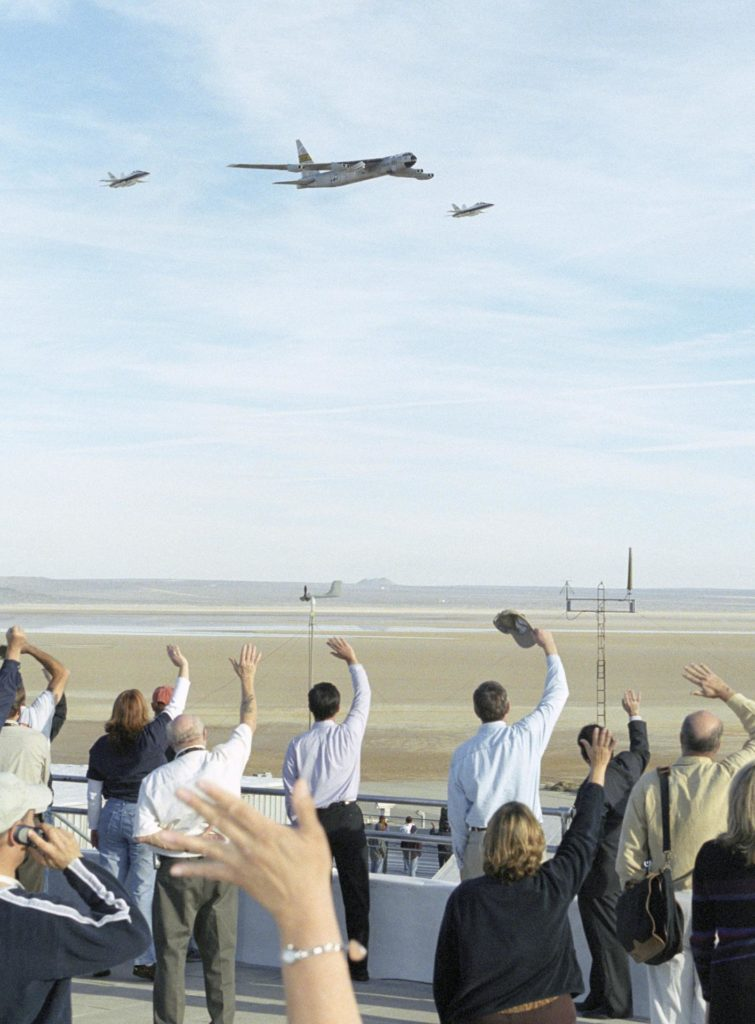 Shadowed by two F/A-18s, NASA Dryden's venerable NB-52B is saluted by employees as it makes its final flyover after the last X-43A launch in November 2004. EC04-0327-39