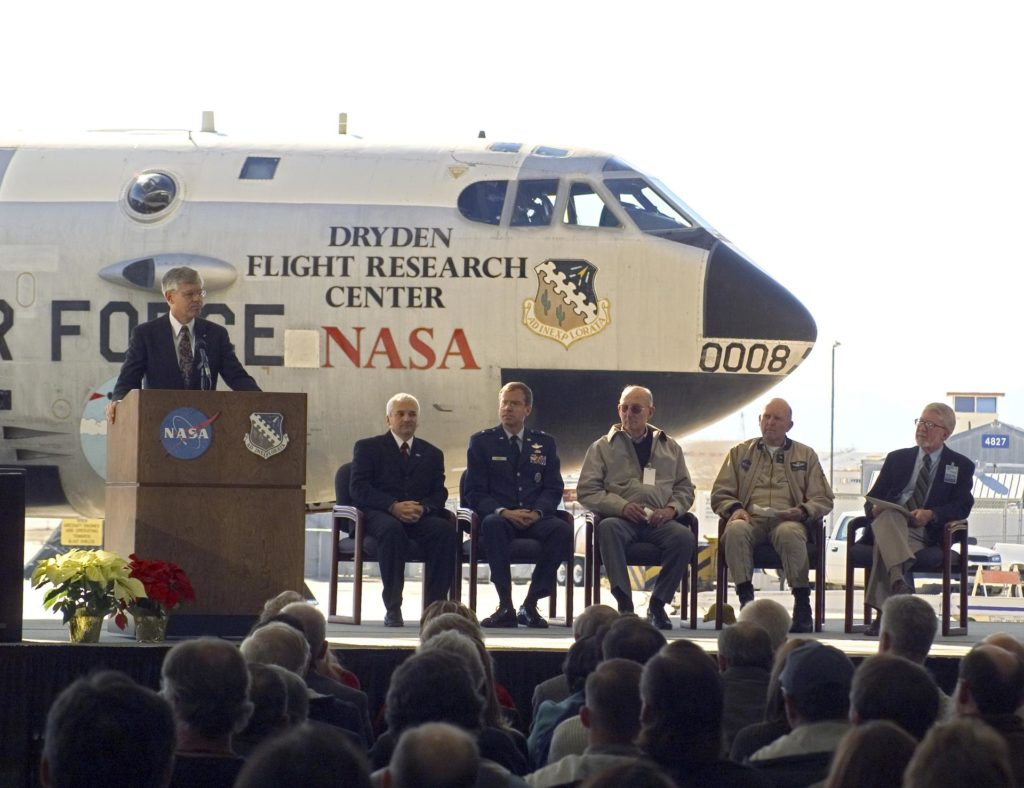 Retired NASA Dryden research pilot Ed Schneider served as master of ceremonies at the retirement ceremony for NASA's B-52B, on Dec. 17, 2004. ED04-0362-01