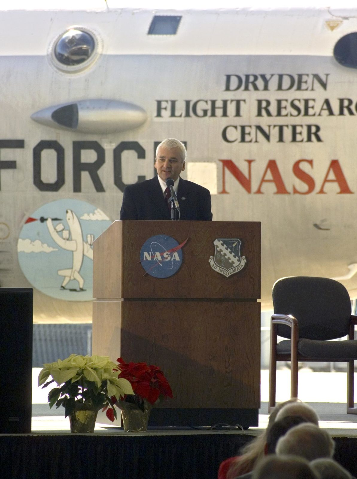 DFRC director Kevin Petersen speaks to an audience of NASA and Air Force visitors, employees and special guests at the retirement ceremony for NASA's B-52B. ED04-0362-07