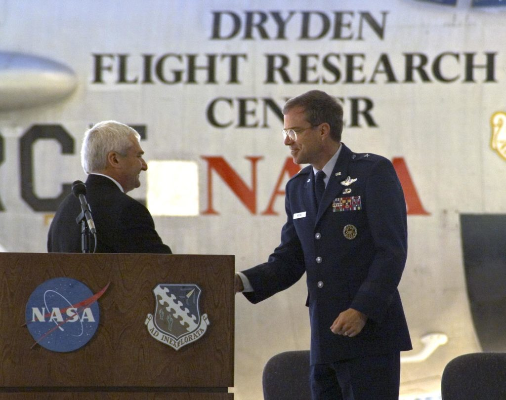 Dryden Center director Kevin Petersen shakes hands with AFFTC commander, Brig. Gen. Curtis Bedke, at the retirement ceremony for NASA's B-52B. ED04-0362-08