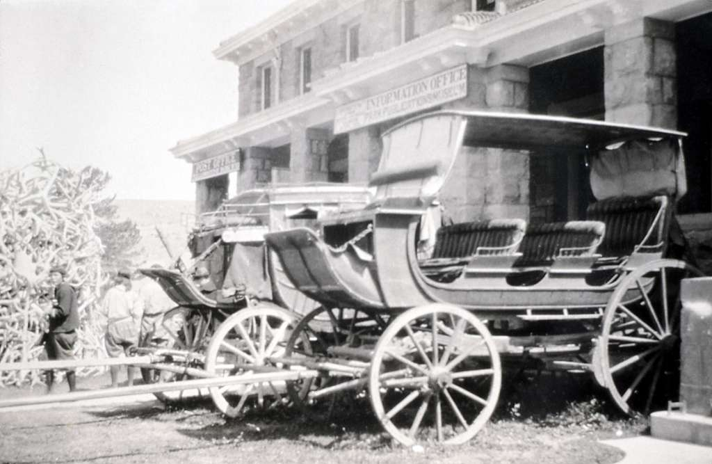 Coaches in front of museum, Mammoth Hot Springs (dedicated Albright Visitor Center in 1979); Photographer unknown; August 11, 1924