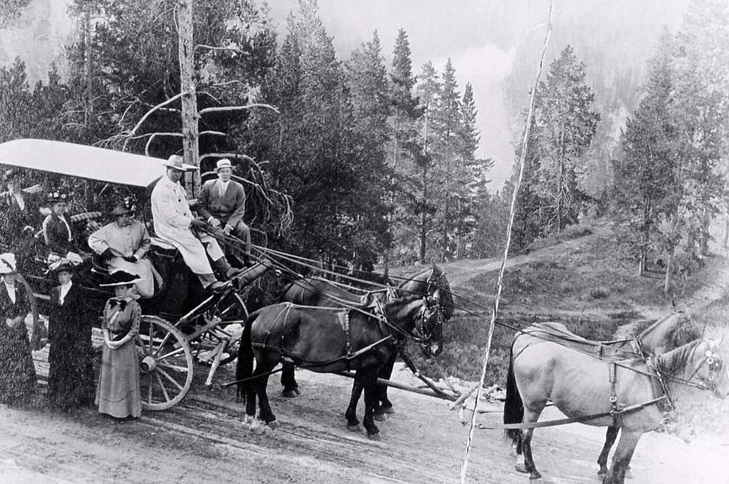 Four horse coach with tourists; Haynes; 1910