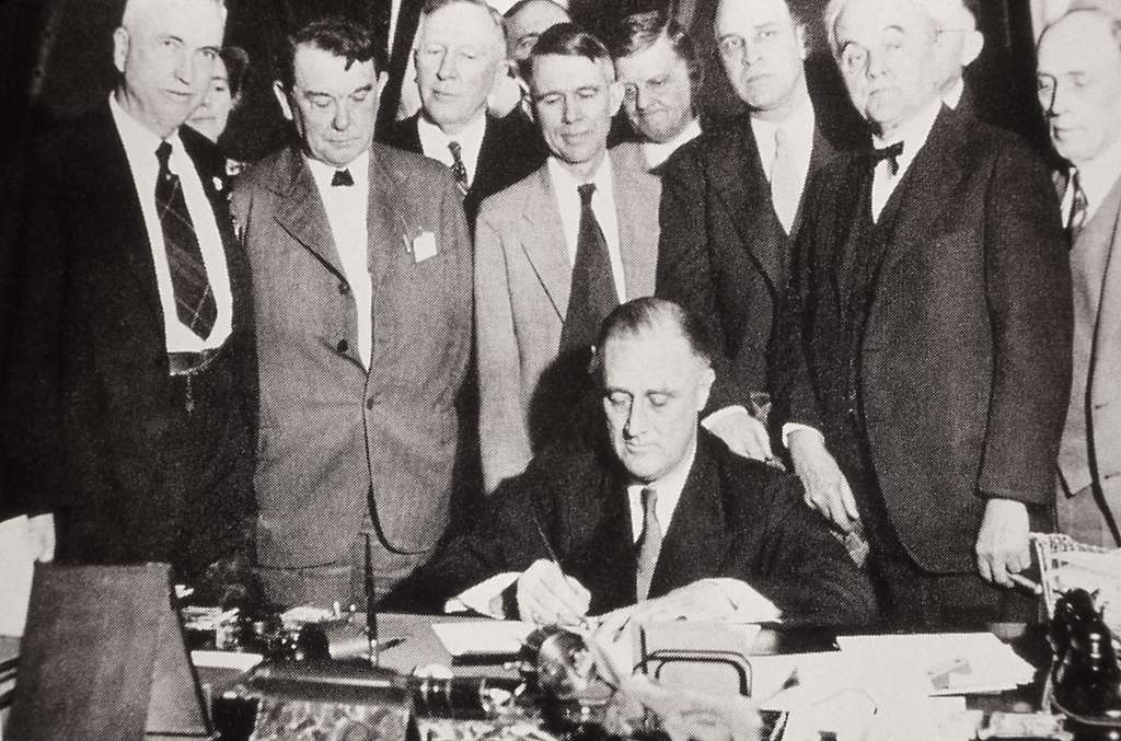 President Franklin D Roosevelt signing the New Deal conservation legislation; Photographer unknown; 1930's