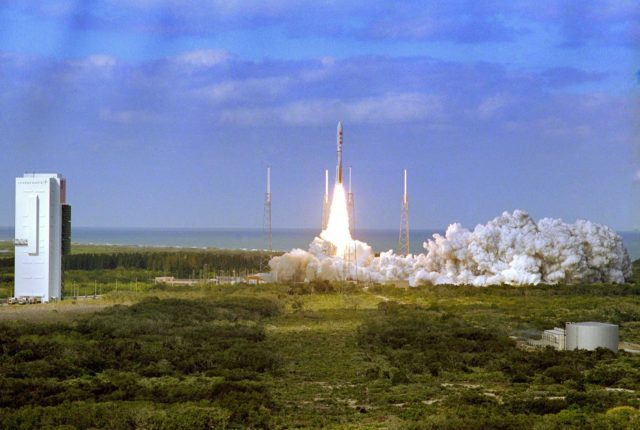 KENNEDY SPACE CENTER, FLA.  —   With the blue Atlantic Ocean as backdrop, smoke and steam fill the launch pad, at right, as NASA's New Horizons spacecraft roars into the sky aboard an Atlas V rocket. Liftoff was on time at 2 p.m. EST from Complex 41 on Cape Canaveral Air Force Station in Florida. This was the third launch attempt in as many days after scrubs due to weather concerns. The compact, 1,050-pound piano-sized probe will get a boost from a kick-stage solid propellant motor for its journey to Pluto. New Horizons will be the fastest spacecraft ever launched, reaching lunar orbit distance in just nine hours and passing Jupiter 13 months later. The New Horizons science payload, developed under direction of Southwest Research Institute, includes imaging infrared and ultraviolet spectrometers, a multi-color camera, a long-range telescopic camera, two particle spectrometers, a space-dust detector and a radio science experiment. The dust counter was designed and built by students at the University of Colorado, Boulder. The launch at this time allows New Horizons to fly past Jupiter in early 2007 and use the planet's gravity as a slingshot toward Pluto. The Jupiter flyby trims the trip to Pluto by as many as five years and provides opportunities to test the spacecraft's instruments and flyby capabilities on the Jupiter system. New Horizons could reach the Pluto system as early as mid-2015, conducting a five-month-long study possible only from the close-up vantage of a spacecraft. KSC-06pp0106