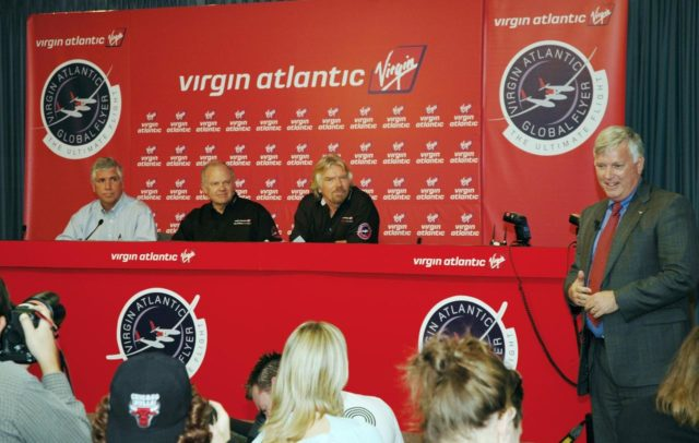 KENNEDY SPACE CENTER, FLA. -  At a press conference at NASA Kennedy Space Center, Jim Kennedy (right), KSC director, introduces the principals in the Virgin Atlantic GlobalFlyer long-distance attempt.   Seated from left are Jim Ball, manager of KSC Spaceport Development; Steve Fossett, the pilot; and Sir Richard Branson, chairman and founder of Virgin Atlantic.  Steve Fossett will pilot the GlobalFlyer on a record-breaking attempt by flying solo, non-stop without refueling, to surpass the current record for the longest flight of any aircraft.  Fossett is expected to take off from the KSC Shuttle Landing Facility early Tuesday morning.  Photo credit: NASA/Jim Grossmann KSC-06pd0195