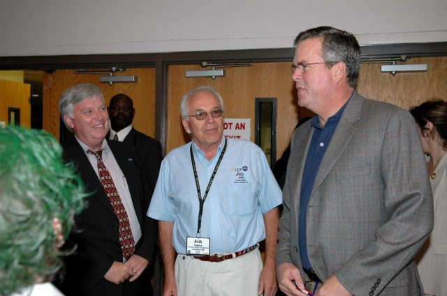"KENNEDY SPACE CENTER, FLA.  - During the 2006 FIRST Robotics Regional Competition held March 9-11 at the University of Central Florida in Orlando, Kennedy Space Center Director Jim Kennedy (left) and Florida Governor Jeb Bush (right) are joined by Erik Halleus, executive chair of the Florida FIRST committee.The FIRST  Robotics Competition challenges teams of young people and their mentors to solve a common problem in a six-week timeframe using a standard ""kit of parts"" and a common set of rules. Teams build robots from the parts and enter them in a series of competitions.  FIRST, which is based on ""For Inspiration and Recognition of Science and Technology,"" redefines winning for these students. Teams are rewarded for excellence in design, demonstrated team spirit, gracious professionalism and maturity, and ability to overcome obstacles. Scoring the most points is a secondary goal. Winning means building partnerships that last.  NASA and the University of Central Florida are co-sponsors of the regional event, which this year included more than 50 teams.  Photo credit: NASA/Kim Shiflett KSC-06pd0459"