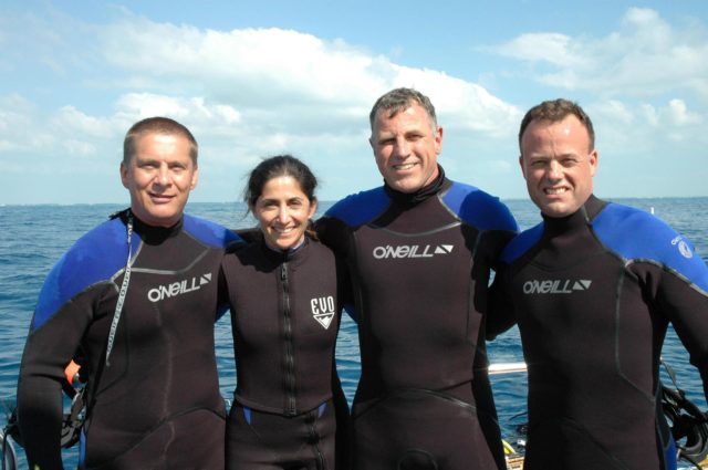 KENNEDY SPACE CENTER, FLA. --  The NASA Extreme Environment Mission Operations (NEEMO) team is ready to begin their 17-day undersea mission in the National Oceanic and Atmospheric Administration (NOAA) Aquarius Underwater Laboratory.  From left are Dr. Tim Broderick of the University of Cincinnati and astronauts Nicole Stott, Dave Williams (team lead) and Ron Garan.  The astronauts are testing space medicine concepts and moon-walking techniques. The undersea laboratory is situated three miles off Key Largo in the Florida Keys National Marine Sanctuary, anchored 62 feet below the surface. KSC-06pd0629