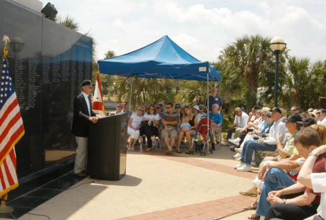 KENNEDY SPACE CENTER, FLA.  - Astronaut John Young speaks to veterans of the space program in front of the U.S. Space Walk of Fame's Gemini Monument in Space View Park in Titusville, Fla.  More than 50 former Gemini workers attended the event marking the 40th anniversary of Project Gemini.  Young, himself a veteran of Project Gemini, told members of the group they should be pleased with their accomplishments, which ultimately helped to land a man on the moon and will lead to future Mars exploration.  Following the ceremony, the former workers and their families enjoyed a guided tour of the Kennedy Space Center. KSC-06pd0701