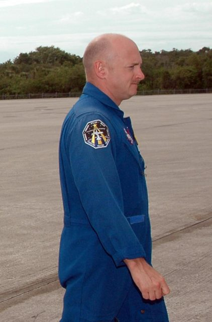 KENNEDY SPACE CENTER, FLA. - After landing at NASA's Kennedy Space Center aboard a Grumman G2 aircraft, the STS-121 crew gathers at a microphone for the media.  Seen here at center is Pilot Mark Kelly.  Other crew members are Mission Commander Steven Lindsey and Mission Specialists Michael Fossum, Lisa Nowak, Stephanie Wilson, Piers Sellers and Thomas Reiter, who represents the European Space Agency.  The crew is at the space center to take part in a Terminal Countdown Demonstration Test, or TCDT. Over several days, the crew will practice emergency egress from the pad and suit up in their orange flight suits for the simulated countdown to launch. Space Shuttle Discovery is designated to launch July 1 on mission STS-121.  It will carry supplies to the International Space Station.  Photo credit: NASA/Kim Shiflett KSC-06pd1042
