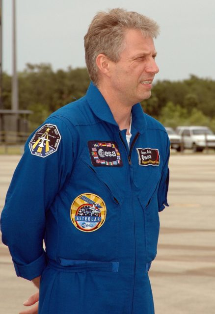 KENNEDY SPACE CENTER, FLA. - After landing at NASA's Kennedy Space Center aboard a Grumman G2 aircraft, the STS-121 crew gathers at a microphone for the media.  Seen here is Mission Specialist Thomas Reiter from Germany, who represents the European Space Agency.  Other crew members are Commander Steven Lindsey, Pilot Mark Kelly, and Mission Specialists Michael Fossum, Lisa Nowak, Stephanie Wilson and Piers Sellers. The crew is at the space center to take part in a Terminal Countdown Demonstration Test, or TCDT. Over several days, the crew will practice emergency egress from the pad and suit up in their orange flight suits for the simulated countdown to launch. Space Shuttle Discovery is designated to launch July 1 on mission STS-121.  It will carry supplies to the International Space Station.  Photo credit: NASA/Kim Shiflett KSC-06pd1047