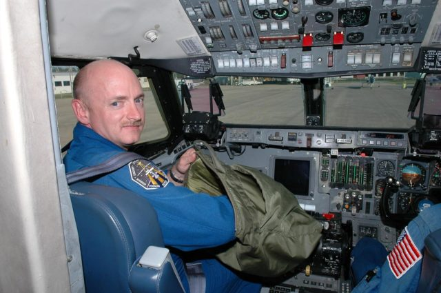 KENNEDY SPACE CENTER, FLA. - At the Shuttle Landing Facility, STS-121 Pilot Mark Kelly gets ready for a training flight in a Shuttle Training Aircraft (STA).  He will be practicing landing the orbiter using the STA, which is a modified Grumman American Aviation-built Gulf Stream II jet that was modified to simulate an orbiter's cockpit, motion and visual cues, and handling qualities. In flight, the STA duplicates the orbiter's atmospheric descent trajectory from approximately 35,000 feet altitude to landing on a runway. Because the orbiter is unpowered during re-entry and landing, its high-speed glide must be perfectly executed the first time. Space Shuttle Discovery is scheduled to launch July 1 on mission STS-121.  Photo credit: NASA/Kim Shiflett KSC-06pd1070