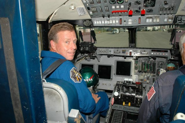 KENNEDY SPACE CENTER, FLA. - At the Shuttle Landing Facility, STS-121 Commander Steven Lindsey gets ready for a training flight in a Shuttle Training Aircraft (STA).  He will be practicing landing the orbiter using the STA, which is a modified Grumman American Aviation-built Gulf Stream II jet that was modified to simulate an orbiter's cockpit, motion and visual cues, and handling qualities. In flight, the STA duplicates the orbiter's atmospheric descent trajectory from approximately 35,000 feet altitude to landing on a runway. Because the orbiter is unpowered during re-entry and landing, its high-speed glide must be perfectly executed the first time. Space Shuttle Discovery is scheduled to launch July 1 on mission STS-121.  Photo credit: NASA/Kim Shiflett KSC-06pd1071