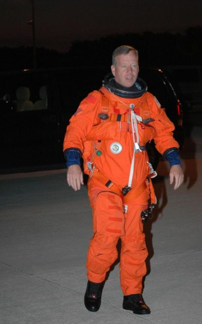KENNEDY SPACE CENTER, FLA. -  In the pre-dawn hours, STS-121 Commander Steven Lindsey walks across the Shuttle Landing Facility to the Shuttle Training Aircraft (STA).  Lindsey and Pilot Mark Kelly will be making practice landings in preparation for the July 1 launch of Space Shuttle Discovery. The STA is a Grumman American Aviation-built Gulf Stream II jet that was modified to simulate an orbiter's cockpit, motion and visual cues, and handling qualities. In flight, the STA duplicates the orbiter's atmospheric descent trajectory from approximately 35,000 feet altitude to landing on a runway. Because the orbiter is unpowered during re-entry and landing, its high-speed glide must be perfectly executed the first time.  Photo credit: NASA/Kim Shiflett KSC-06pd1256