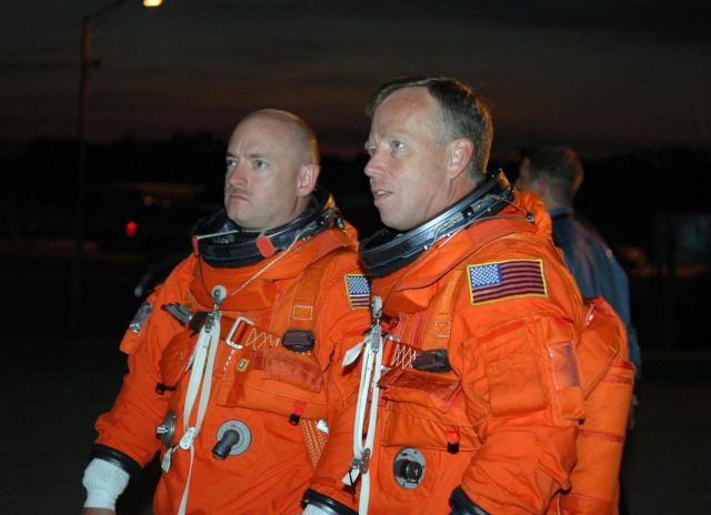 KENNEDY SPACE CENTER, FLA. -    In the pre-dawn hours, STS-121 Pilot Mark Kelly (left) and Commander Steven Lindsey look at the Shuttle Training Aircraft (STA) they will be flying to practice landings in preparation for the July 1 launch of Space Shuttle Discovery.   The STA is a Grumman American Aviation-built Gulf Stream II jet that was modified to simulate an orbiter's cockpit, motion and visual cues, and handling qualities. In flight, the STA duplicates the orbiter's atmospheric descent trajectory from approximately 35,000 feet altitude to landing on a runway. Because the orbiter is unpowered during re-entry and landing, its high-speed glide must be perfectly executed the first time.  Photo credit: NASA/Kim Shiflett KSC-06pd1258
