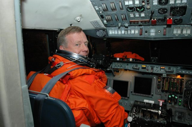 KENNEDY SPACE CENTER, FLA. -  Inside the Shuttle Training Aircraft (STA), STS-121 Commander Steven Lindsey settles into his seat in the cockpit.  Lindsey and Pilot Mark Kelly will be making practice landings in preparation for the July 1 launch of Space Shuttle Discovery.  The STA is a Grumman American Aviation-built Gulf Stream II jet that was modified to simulate an orbiter's cockpit, motion and visual cues, and handling qualities. In flight, the STA duplicates the orbiter's atmospheric descent trajectory from approximately 35,000 feet altitude to landing on a runway. Because the orbiter is unpowered during re-entry and landing, its high-speed glide must be perfectly executed the first time.  Photo credit: NASA/Kim Shiflett KSC-06pd1259
