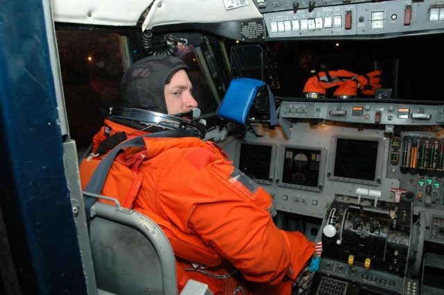 KENNEDY SPACE CENTER, FLA. -  Inside the Shuttle Training Aircraft (STA), STS-121 Pilot Mark Kelly takes control in the cockpit.  Kelly and Commander Steven Lindsey will be making practice landings in preparation for the July 1 launch of Space Shuttle Discovery.  The STA is a Grumman American Aviation-built Gulf Stream II jet that was modified to simulate an orbiter's cockpit, motion and visual cues, and handling qualities. In flight, the STA duplicates the orbiter's atmospheric descent trajectory from approximately 35,000 feet altitude to landing on a runway. Because the orbiter is unpowered during re-entry and landing, its high-speed glide must be perfectly executed the first time.  Photo credit: NASA/Kim Shiflett KSC-06pd1260