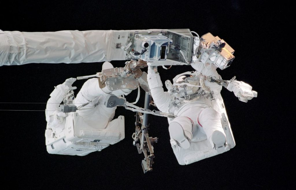 Sellers and Fossum on the end of the OBSS during EVA1 on STS-121 / Expedition 13 joint operations