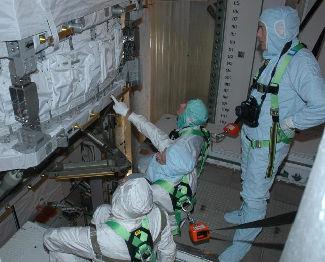 KENNEDY SPACE CENTER, FLA. -    In the payload changeout room on Launch Pad 39B, STS-115 crew members look over the mission payload one more time before launch. From left are mission specialists Joseph Tanner, Daniel Burbank, Steven MacLean, who represents the Canadian Space Agency, and Heidemarie Stefanyshyn-Piper (standing). The mission crew has been at KSC to take part in Terminal Countdown Demonstration Test activities, which include emergency egress training, a simulated launch countdown and the payload familiarization. The TCDT is a prelaunch preparation for the mission that is scheduled to lift off in a window opening Aug. 27. During their 11-day mission to the International Space Station, the STS-115 crew will continue construction of the station and attach the payload elements, the Port 3/4 truss segment with its two large solar arrays. Photo credit: NASA/Cory Huston KSC-06pd1851