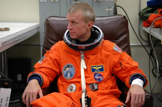 KENNEDY SPACE CENTER, FLA. - STS-115 Commander Brent Jett dons his launch suit before flying the Shuttle Training Aircraft to practice landing the shuttle. STA practice is part of launch preparations. The STA is a Grumman American Aviation-built Gulf Stream II jet that was modified to simulate an orbiter's cockpit, motion and visual cues, and handling qualities. In flight, the STA duplicates the orbiter's atmospheric descent trajectory from approximately 35,000 feet altitude to landing on a runway. Because the orbiter is unpowered during re-entry and landing, its high-speed glide must be perfectly executed the first time. Mission STS-115 is scheduled to lift off about 12:29 p.m. Sept. 6. Mission managers cancelled Atlantis' first launch campaign due to a lightning strike at the pad and the passage of Tropical Storm Ernesto along Florida's east coast. The mission will deliver and install the 17-and-a-half-ton P3/P4 truss segment to the port side of the integrated truss system on the orbital outpost. The truss includes a new set of photovoltaic solar arrays. When unfurled to their full length of 240 feet, the arrays will provide additional power for the station in preparation for the delivery of international science modules over the next two years. STS-115 is expected to last 11 days and includes three scheduled spacewalks. Photo credit: NASA/Kim Shiflett KSC-06pd2022