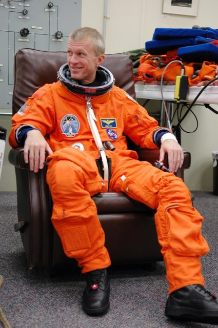 KENNEDY SPACE CENTER, FLA. - STS-115 Commander Brent Jett is dressed in his launch suit before flying the Shuttle Training Aircraft to practice landing the shuttle. STA practice is part of launch preparations. The STA is a Grumman American Aviation-built Gulf Stream II jet that was modified to simulate an orbiter's cockpit, motion and visual cues, and handling qualities. In flight, the STA duplicates the orbiter's atmospheric descent trajectory from approximately 35,000 feet altitude to landing on a runway. Because the orbiter is unpowered during re-entry and landing, its high-speed glide must be perfectly executed the first time. Mission STS-115 is scheduled to lift off about 12:29 p.m. Sept. 6. Mission managers cancelled Atlantis' first launch campaign due to a lightning strike at the pad and the passage of Tropical Storm Ernesto along Florida's east coast. The mission will deliver and install the 17-and-a-half-ton P3/P4 truss segment to the port side of the integrated truss system on the orbital outpost. The truss includes a new set of photovoltaic solar arrays. When unfurled to their full length of 240 feet, the arrays will provide additional power for the station in preparation for the delivery of international science modules over the next two years. STS-115 is expected to last 11 days and includes three scheduled spacewalks. Photo credit: NASA/Kim Shiflett KSC-06pd2023