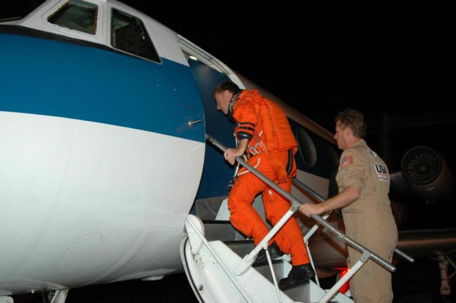 KENNEDY SPACE CENTER, FLA. - On NASA Kennedy Space Center's Shuttle Landing Facility, STS-115 Pilot Christopher Ferguson boards the Shuttle Training Aircraft to practice landing the shuttle. STA practice is part of launch preparations. The STA is a Grumman American Aviation-built Gulf Stream II jet that was modified to simulate an orbiter's cockpit, motion and visual cues, and handling qualities. In flight, the STA duplicates the orbiter's atmospheric descent trajectory from approximately 35,000 feet altitude to landing on a runway. Because the orbiter is unpowered during re-entry and landing, its high-speed glide must be perfectly executed the first time. Mission STS-115 is scheduled to lift off about 12:29 p.m. Sept. 6. Mission managers cancelled Atlantis' first launch campaign due to a lightning strike at the pad and the passage of Tropical Storm Ernesto along Florida's east coast. The mission will deliver and install the 17-and-a-half-ton P3/P4 truss segment to the port side of the integrated truss system on the orbital outpost. The truss includes a new set of photovoltaic solar arrays. When unfurled to their full length of 240 feet, the arrays will provide additional power for the station in preparation for the delivery of international science modules over the next two years. STS-115 is expected to last 11 days and includes three scheduled spacewalks. Photo credit: NASA/Kim Shiflett KSC-06pd2026