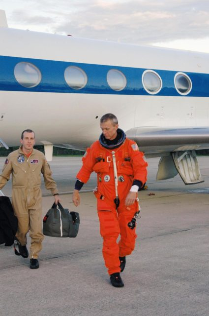 KENNEDY SPACE CENTER, FLA. - On NASA Kennedy Space Center's Shuttle Landing Facility, STS-115 Commander Brent Jett leaves the Shuttle Training Aircraft after a practice session of landing the shuttle. STA practice is part of launch preparations. The STA is a Grumman American Aviation-built Gulf Stream II jet that was modified to simulate an orbiter's cockpit, motion and visual cues, and handling qualities. In flight, the STA duplicates the orbiter's atmospheric descent trajectory from approximately 35,000 feet altitude to landing on a runway. Because the orbiter is unpowered during re-entry and landing, its high-speed glide must be perfectly executed the first time. Mission STS-115 is scheduled to lift off about 12:29 p.m. Sept. 6. Mission managers cancelled Atlantis' first launch campaign due to a lightning strike at the pad and the passage of Tropical Storm Ernesto along Florida's east coast. The mission will deliver and install the 17-and-a-half-ton P3/P4 truss segment to the port side of the integrated truss system on the orbital outpost. The truss includes a new set of photovoltaic solar arrays. When unfurled to their full length of 240 feet, the arrays will provide additional power for the station in preparation for the delivery of international science modules over the next two years. STS-115 is expected to last 11 days and includes three scheduled spacewalks. Photo credit: NASA/Kim Shiflett KSC-06pd2036