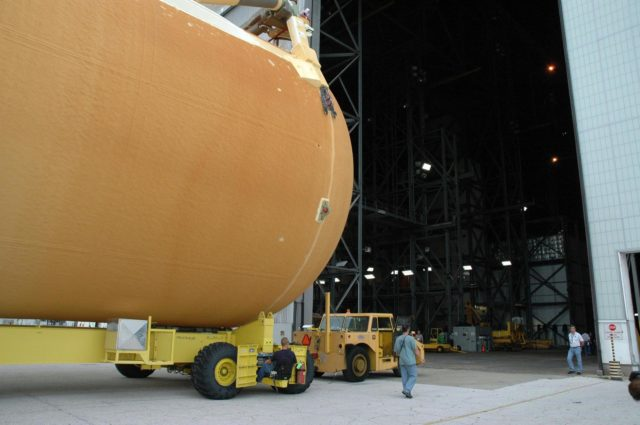 KENNEDY SPACE CENTER, FLA. -  External tank No. 123 heads into the open doorway of the Vehicle Assembly Building. Once inside the VAB, the tank will be lifted into a checkout cell for further work.  Shipped from NASA's Michoud Assembly Facility in New Orleans aboard the Pegasus barge, the tank has undergone major safety changes, including removal of the protuberance air load ramps.  It is designated to launch Space Shuttle Discovery on mission STS-116 in December.  Mission STS-116 will deliver the P5 truss segment, a SPACEHAB module and other key components to the International Space Station.  Launch is currently scheduled no earlier than Dec. 14.  Photo credit: NASA/Jack Pfaller KSC-06pd2182