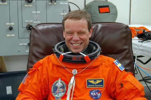 KENNEDY SPACE CENTER, FLA. --  The STS-116 mission crew practices for launch with a simulation of activities, from crew breakfast and suit-up to countdown in the orbiter.  In this photo Mission Specialist Christer Fuglesang, who represents the European Space Agency, grins in anticipation of the launch countdown.  When he is completely suited he will head to Launch Pad 39B.  The STS-116 mission is No. 20 to the International Space Station and construction flight 12A.1.  The mission payload is the SPACEHAB module, the P5 integrated truss structure and other key components. Launch is scheduled for no earlier than Dec. 7. Photo credit: NASA/Kim Shiflett KSC-06pd2586