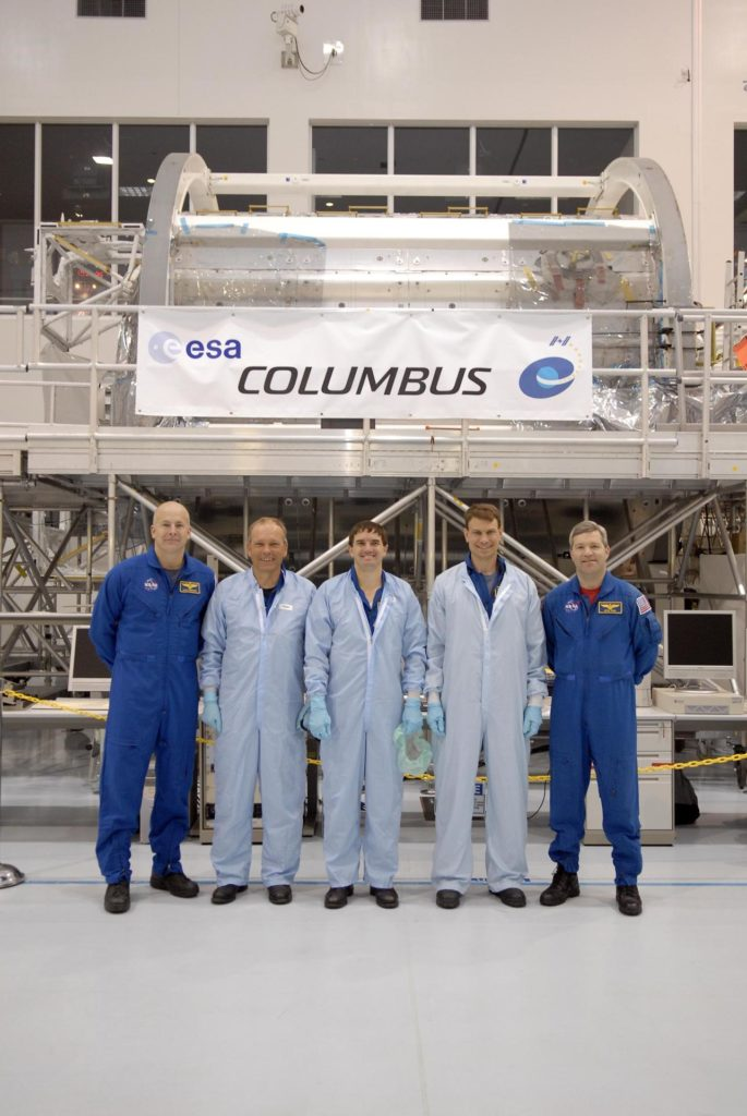 KENNEDY SPACE CENTER, FLA. --   In the Space Station Processing Facility, STS-122 crew members pause for a photo in front of the Columbus European Laboratory, part of the payload on their mission. From left are Pilot Alan Poindexter, Mission Specialists Hans Schlegel, Rex Walheim and Stan Love, and Commander Steve Frick. Schlegel represents the European Space Agency.  The crew is participating in a crew equipment interface test that provides opportunities for hands-on experience with payloads and equipment. The 24th mission to the International Space Station, STS-122 will also include the Multi-Purpose Experiment Support Structure - Non-Deployable (MPESS-ND). Launch of STS-122 on Space Shuttle Discovery is scheduled no earlier than October. Photo credit: NASA/Kim Shiflett KSC-07pd0060