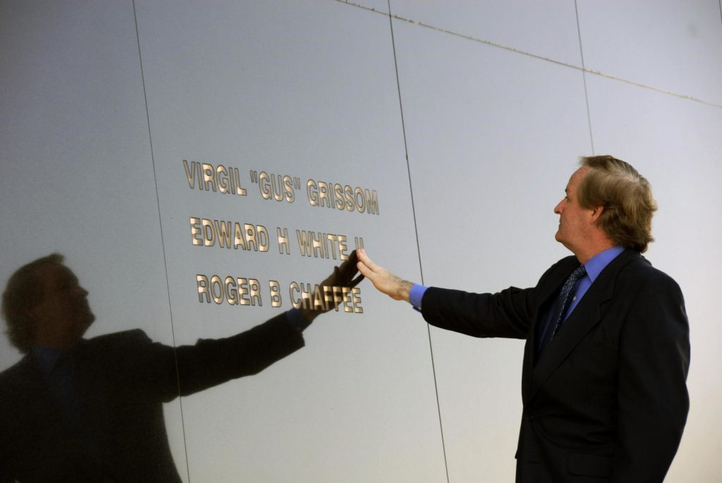 """KENNEDY SPACE CENTER, FLA. --  Ed White III touches his father's name engraved in the Space Mirror Memorial at the KSC Visitor Complex.  White attended the ceremony held in remembrance of the astronauts lost in the Apollo 1 fire: Virgil """"Gus"""" Grissom, Edward H. White II and Roger B. Chaffee.  Members of their families, along with KSC Director Bill Parsons, Associate Administrator for Space Operations William Gerstenmaier, President of the Astronauts Memorial Foundation Stephen Feldman and Chairman of the Board of Directors of the Astronauts Memorial Foundation William Potter, attended the ceremony.  The mirror was designated as a national memorial by Congress and President George Bush in 1991 to honor fallen astronauts.  Their names are emblazoned on the monument's 42-½-foot-high by 50-foot-wide black granite surface as if to be projected into the heavens. Photo credit:NASA/Kim Shiflett KSC-07pd0180"""