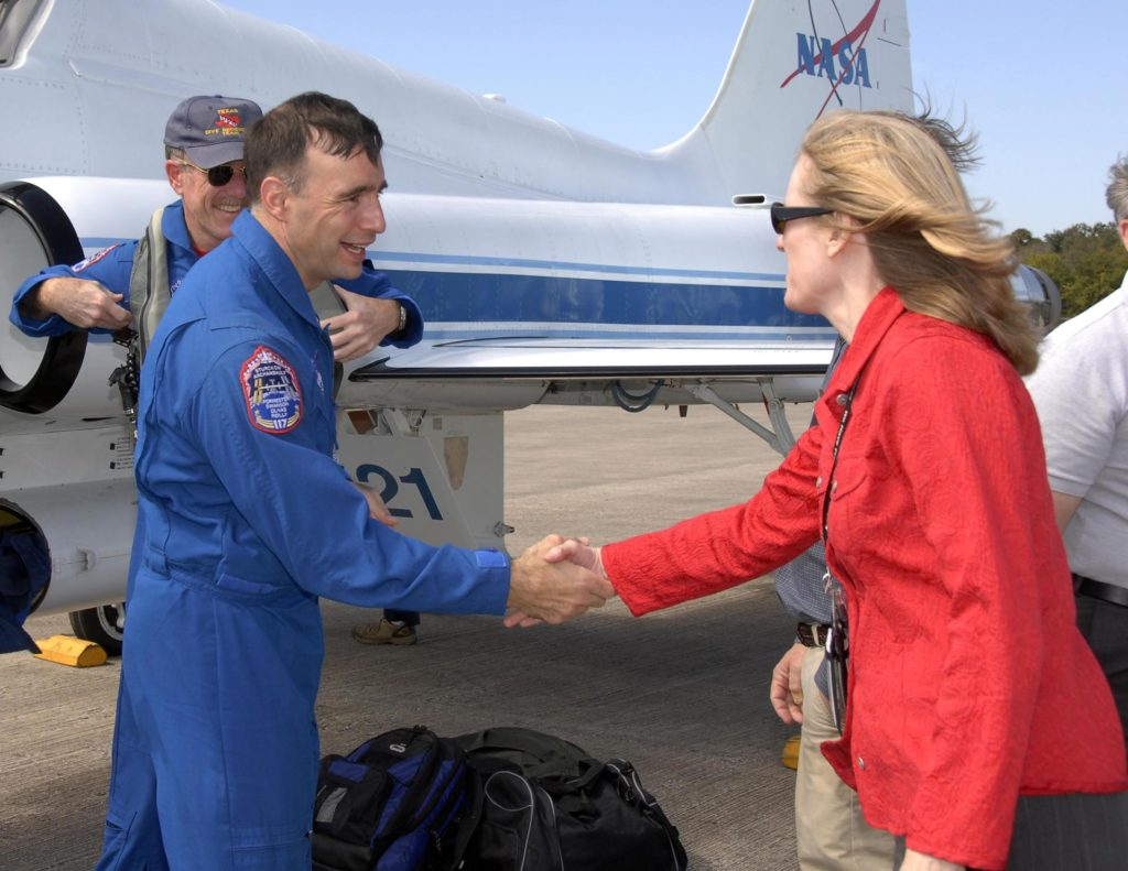 KENNEDY SPACE CENTER, FLA. -- The STS-117 crew arrives at NASA's Kennedy Space Center to take part in the Terminal Countdown Demonstration Test (TCDT), a preparation for the launch March 15 to the International Space Station. Atlantis (OV104) Flow Director Angela Brewer greets Pilot Lee Archambault after he arrives at the Shuttle Landing Facility. The TCDT includes emergency egress training and a simulated launch countdown. The mission payload aboard Space Shuttle Atlantis is the S3/S4 integrated truss structure, along with a third set of solar arrays and batteries. The crew of six astronauts will install the truss to continue assembly of the station.  Photo credit: NASA/Kim Shiflett KSC-07pd0459