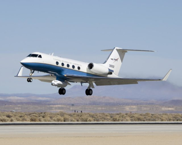 An eight-foot-long pod designed to carry a synthetic aperture radar hangs from the underbelly of NASA's Gulfstream-III research testbed. ED07-0027-54
